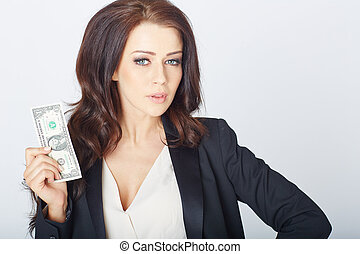 Young businesswoman with a dollar in hand in a white studio