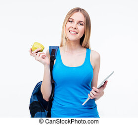 Smiling woman holding apple and tablet computer