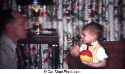 (8mm Vintage) Man Taughting Child
