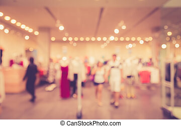 Blurred image of people in shopping mall with bokeh, vintage...