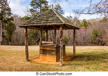 old historic water well in the forest