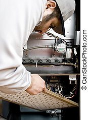 HVAC technician - Stock image of HVAC technician replacing...