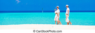 Family vacation - Happy beautiful family on a beach during...