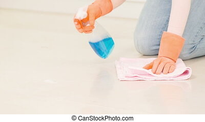 Woman cleans white floor - Very tidy cleaning Charwoman...