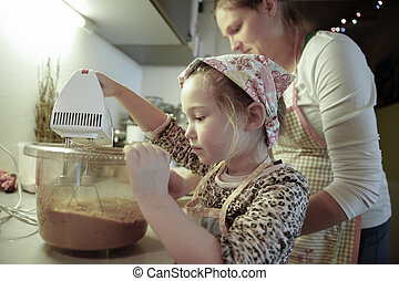 Mother and daughter preparing dough in the kitchen - Mother...