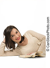 Reading is brain food - Beautiful woman reading a book lying...