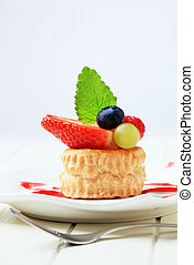 Custard filled puff pastry shell topped with berry fruit