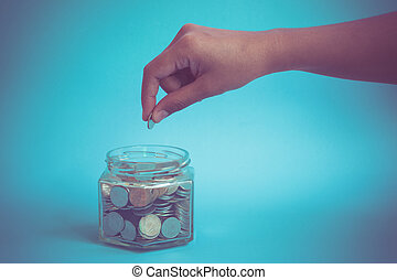 hand putting money coins with filter effect retro vintage...
