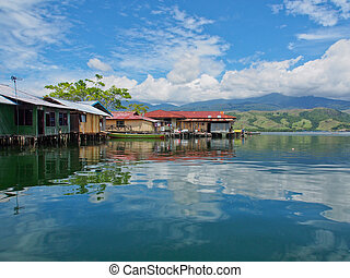 Lake Sentai - Jayapura, Indonesia - January 24, 2015: houses...