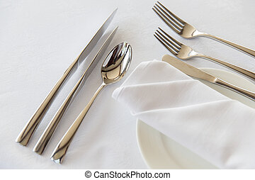 close up of cutlery set on table