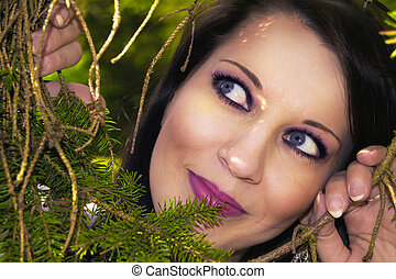 Pretty woman hiding behind the trees