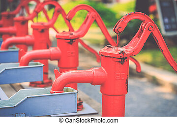 Red retro style hand water pump - Close up red retro style...