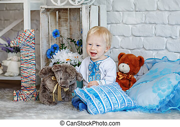 Little blond boy in traditional Ukrainian embroidered shirt...