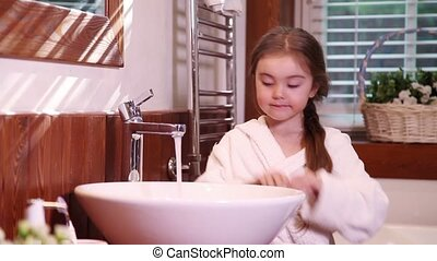 Washing hands - good habit - Little girl washing her hands...