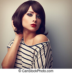 Beautiful female model with short hair style in casual dress...