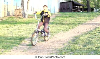 Young school boy on a bicycle