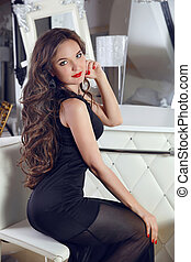 elegant lady. beautiful girl model with long wavy hair...
