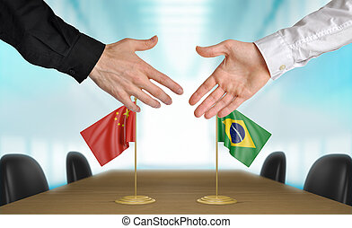 China and Brazil diplomats agreeing on a deal.