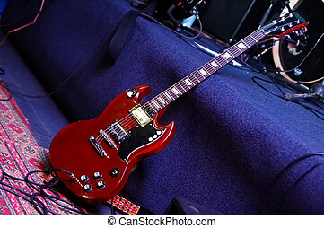 concerto - red electric guitar on scene