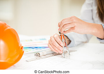 Designer - Close-up of interior designer working with...