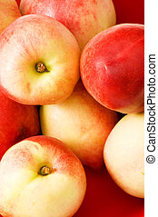 Healthy eating concept - close up of nectarines