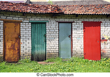 Row of colored doors - red, yellow, blue, green Outdoor