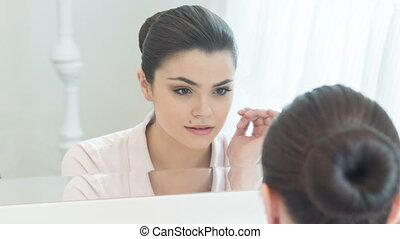 Young woman setting right her make-up - I need to set right...