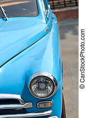 retro car - view from front side, headlamp and bumper