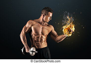 Muscular man with dumbbells on dark background - Handsome...