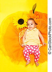 Sweet African baby in doted pants and yellow shirt - Sweet...