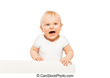 Angry small baby with open mouth in white bodysuit - Angry...