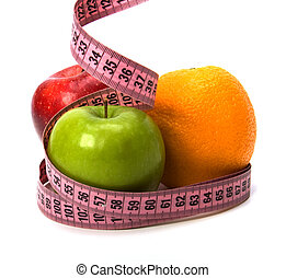 tape measure wrapped around fruits isolated on white...