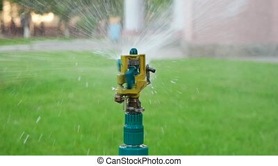 Macro of garden sprinkler working slowmotion - Macro of...