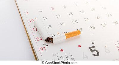 World No Tobacco Day : Broken cigarette on calendar ,sun...