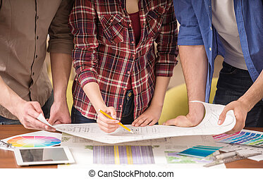 Designers - Close-up of three young creative designers...