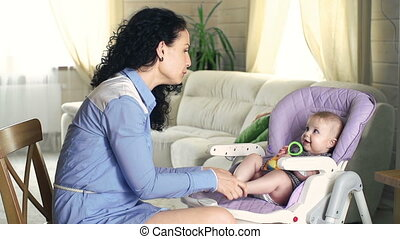 Learning Games - Side view of mother touching delicately the...