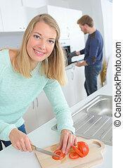 Happy woman preparing vegetables
