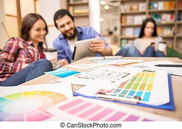 Designers - Creative people having coffee break at office...