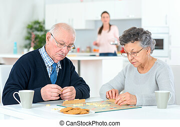 Old couple playing a board game