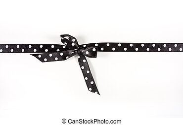 Polka Dot Ribbon - Black and white Polka Dot Ribbon tied in...