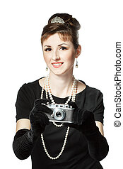 Portrait of a beautiful young woman with vintage camera -...