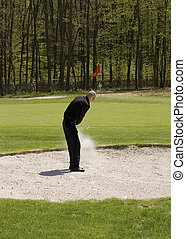 sand save - Golfer saving golf ball from a bunker