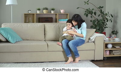 Handclapping Activity - Front view of Hispanic lady nursing...