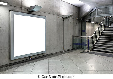 Blank billboard located in underground hall, London, United...