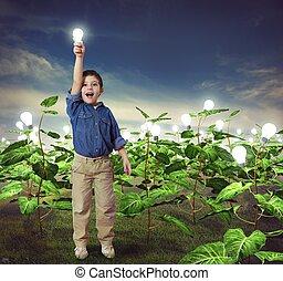 Lightbulb in a ideas field - Baby with lightbulb in a ideas...