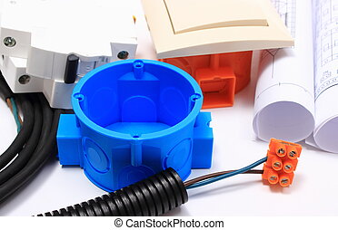 Components for electrical installations and rolls of...
