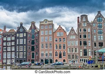 Beautiful houses of Amsterdam along city canal.