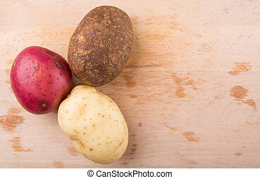 Red, Brown, Yellow Potatoes - Red, brown, yellow potatoes on...