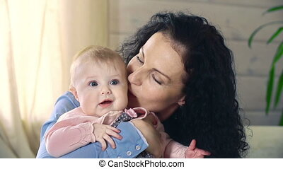 Little Ears - Close up of attractive brunette mother holding...