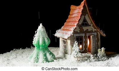 toy house and fir-tree in snow